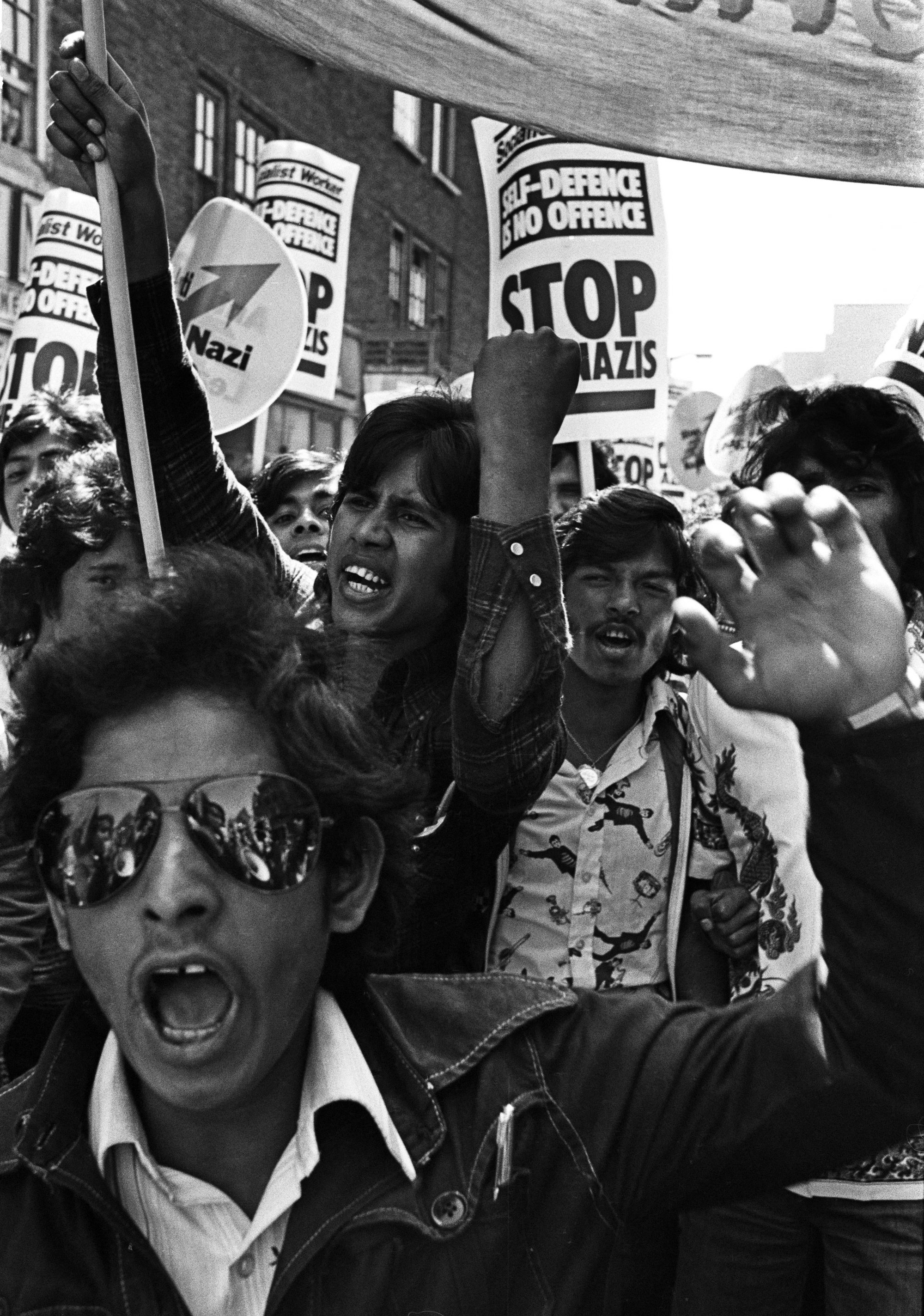 Bengali youths lead a demonstration. Brick Lane, London 1978 by Syd Shelton
