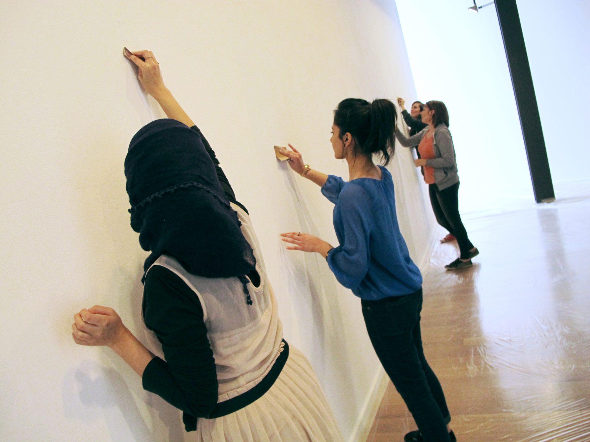 Volunteers helping prepare the gallery