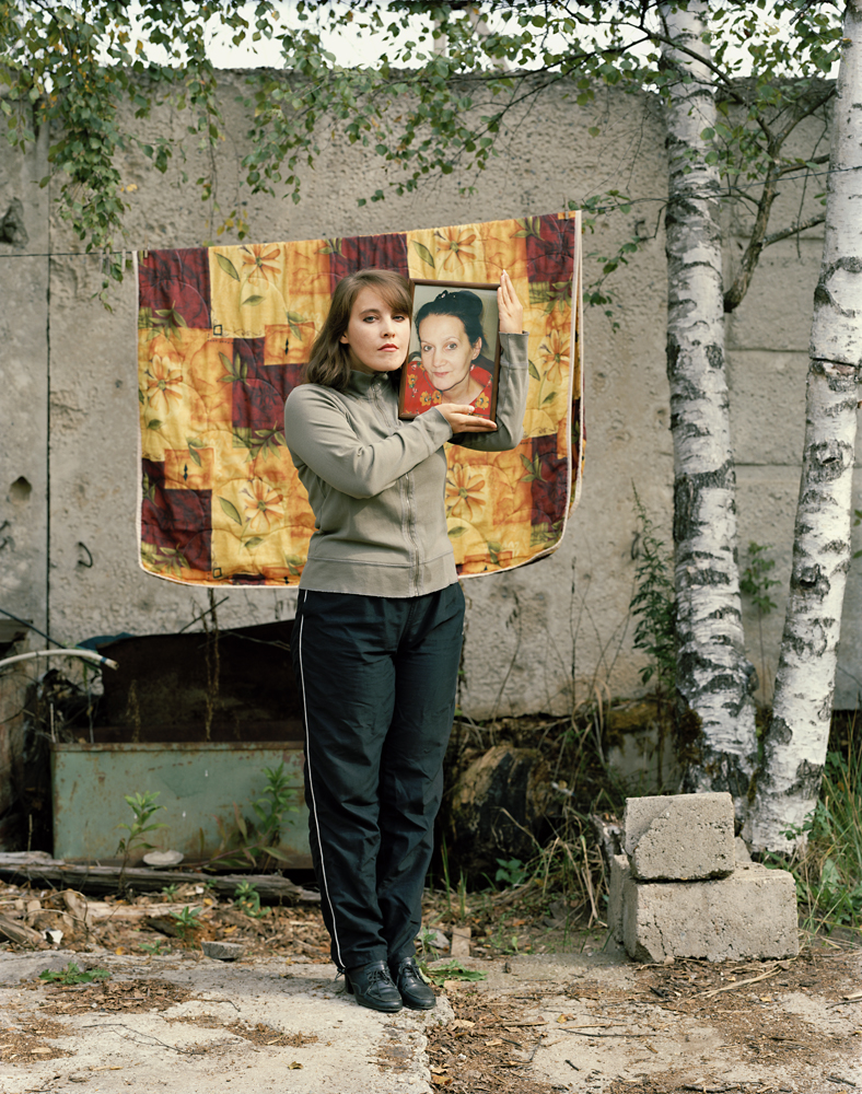 Margaret holding a photograph of her mother (who is currently in cryonic-suspension) by Murray Ballard