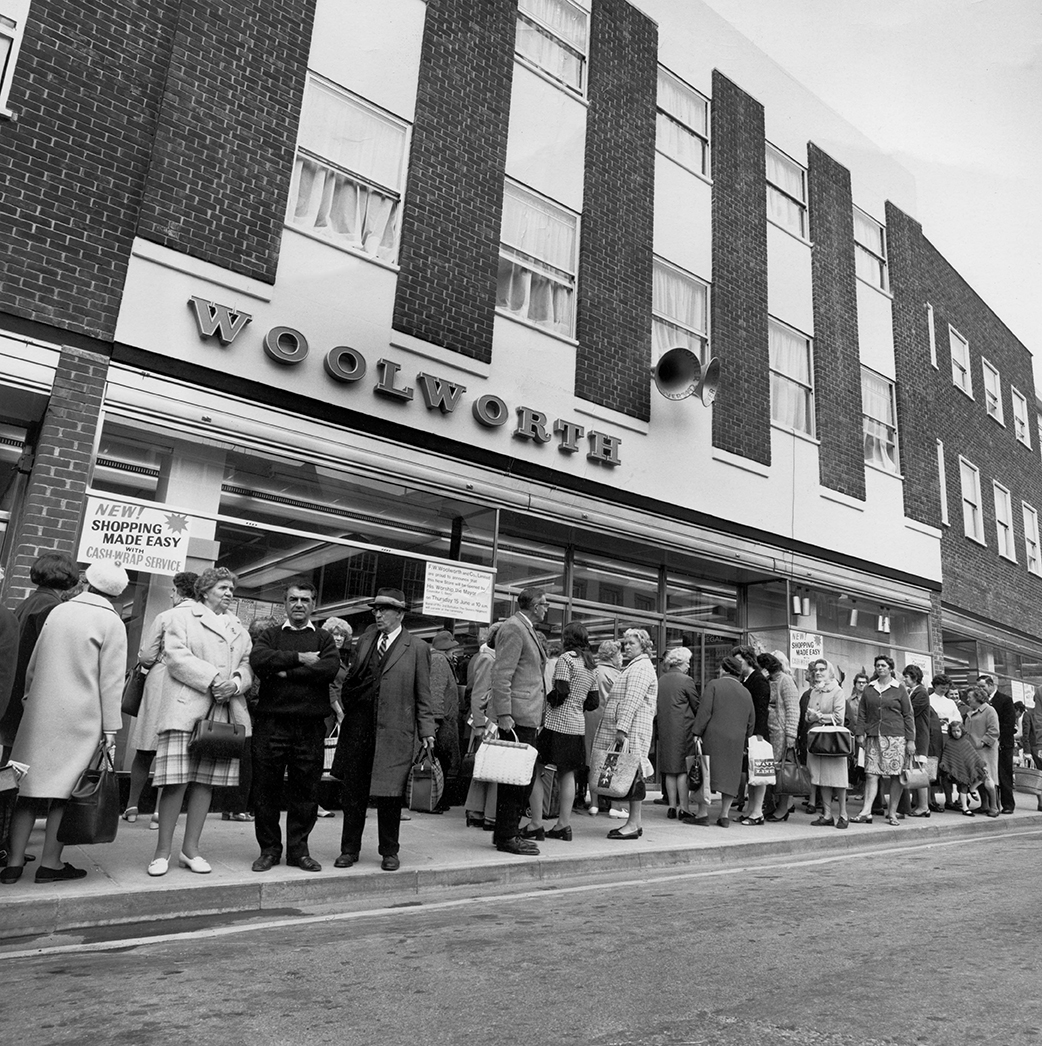 A crowd of people gathered outside the Andover branch of Woolworth at 11-15 High Street, Andover